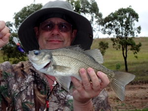 John Beath catches his first trophy Australian bass while fishing Lake St. Clair in New South Wales Australia.