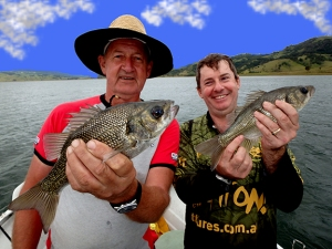 Bill & Bruce both hooked up with nice Australian bass while trolling through a school of bass near shore in a small cove on Lake St. Clair in New South Wales Australia.